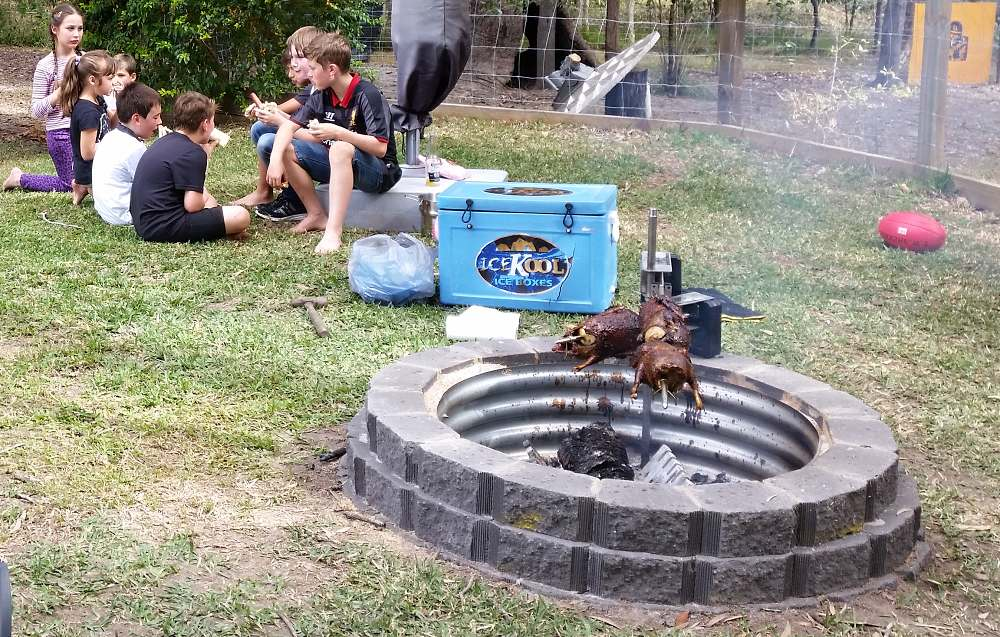 auspit working in fire pit roasting ducks 2.jpg