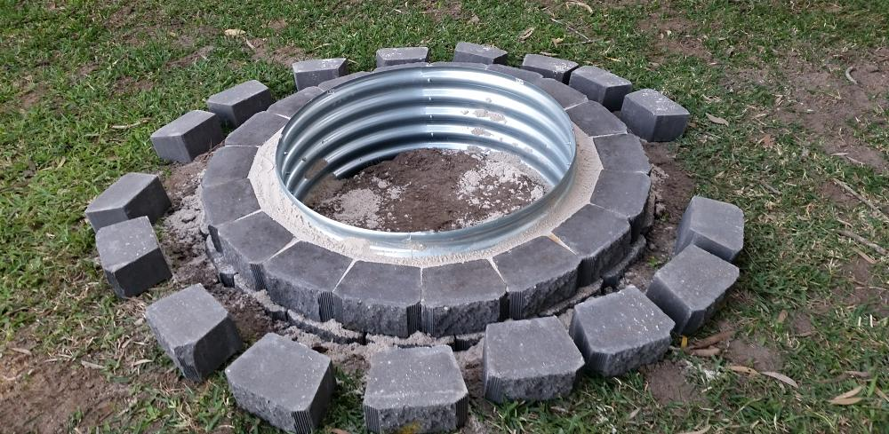 building fire pit step 7 fill sand up to level 2 brick.jpg