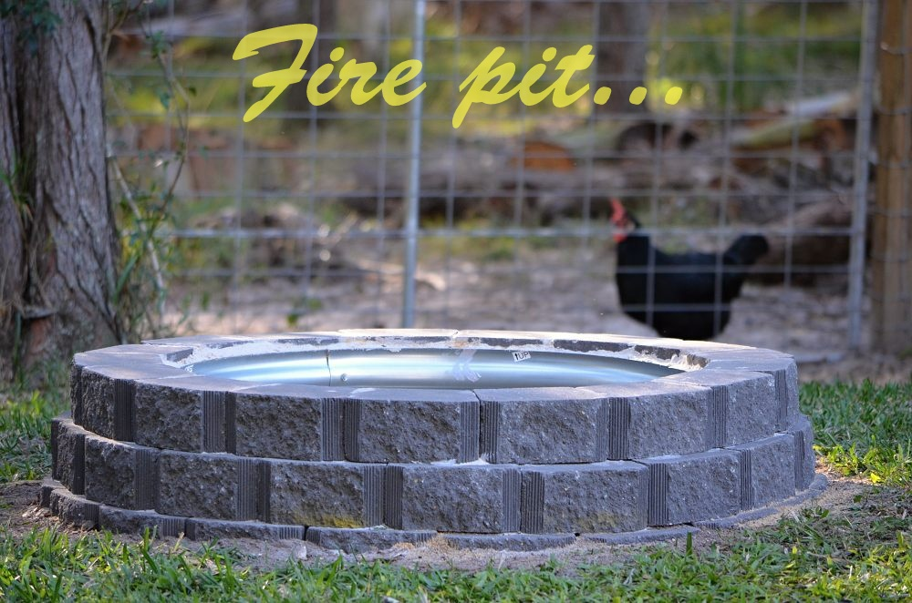 fire pit made from retaining wall bricks and galvanised centre rim.jpg