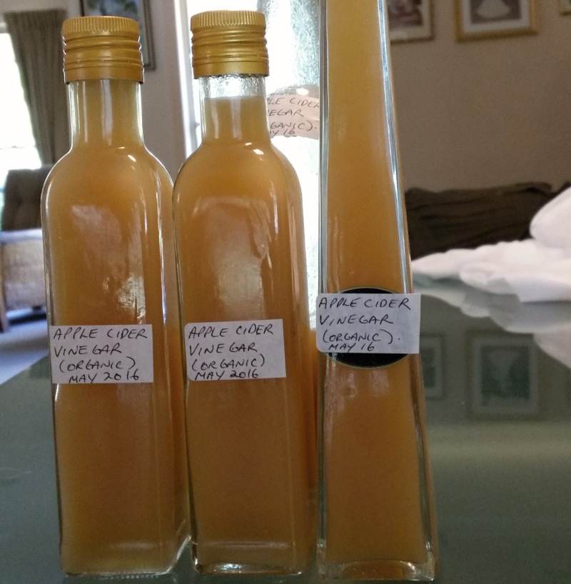 homemade apple cider vinegar organic in bottles.jpg