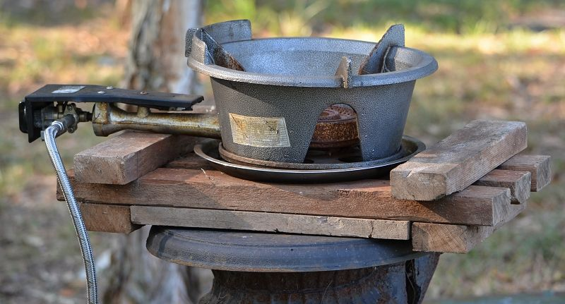 Outdoor Wok On Pot Belly Stove Close Jpg