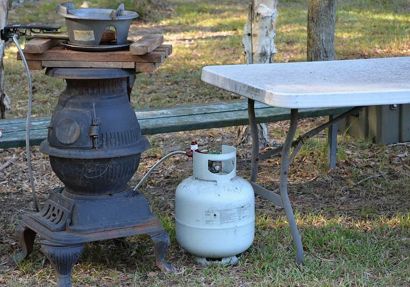 outdoor wok on pot belly stove.jpg