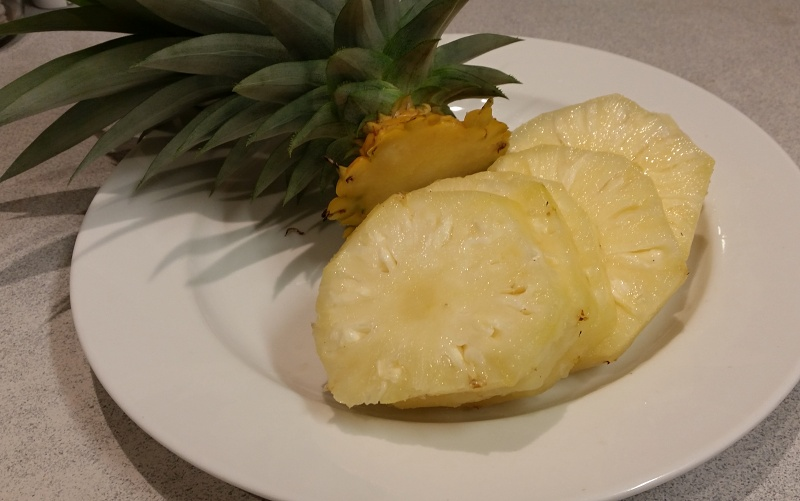 pineapple homegrown organic cut on plate.jpg