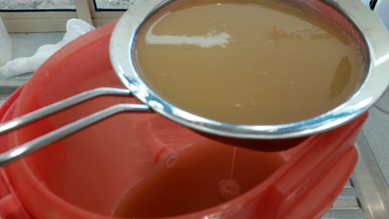 second straining apple cider vinegar through sieve.jpg